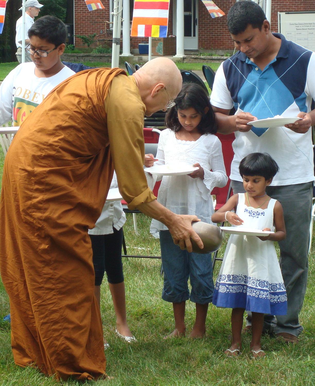 Ajahn Viradammo on alms round. Photo credit: Lee